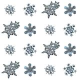 Real snowflakes isolated on white background. Macro photo of real snow crystals: large stellar dendrites with complex, elegant shapes, fine hexagonal symmetry Stock Photo