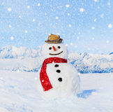 Real Snowman Outdoors In White Scenery stock photo