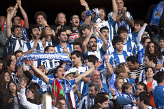 Real sociedad supporters celebrating goal. During a Spanish league match against RCD Espanyol at the Estadi Cornella on November 30, 2013 in Barcelona, Spain Royalty Free Stock Photography