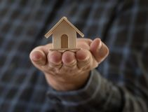 Real State Concept. Hands Holding a House. Real state concept. Man holding a small house in his hand stock photo