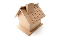 Real State. A dummy wooden house on white background stock image