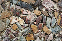 Real stone wall. Surface with cement Royalty Free Stock Image