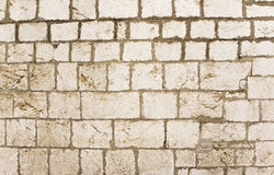Real stone wall texture background. Pattern color of modern style design decorative uneven, real stone wall surface with cement royalty free stock photos