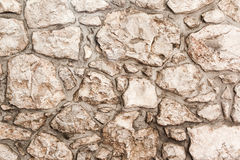 Real stone wall texture background. Pattern color of modern style design decorative uneven, real stone wall surface with cement stock photos