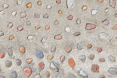 Real stones in cement wall, natural abstract background. Stock Image