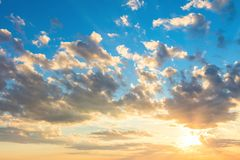 Real sunrise sky with beautiful light clouds, sun and sunbeams stock photos