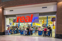Real Supermarket Cash Out. Real Supermarket Exit: People Paying For Their Products At The Cash Registers. Real is a European hypermarket, member of the German stock photo