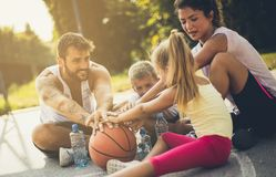 The real team never loses. Family on basketball playground. Close up royalty free stock photography