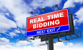 Real Time Bidding on Red Billboard. Stock Photo