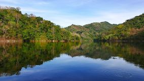 Balanan Lake View 06. A real time clip showing the scenic delights of the mountain lake Balanan in Negros Oriental, Philippines. The lake is quite calm, so it stock footage