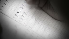 A real-time footage of a pupil writing digits in the square grid exercise book stock video