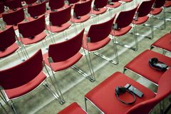 Real time translation devices. Lay on chairs before conference Royalty Free Stock Image
