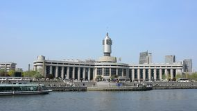 Real time video of Tianjin railway station with clear blue sky. stock video footage