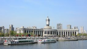Real time video of Tianjin railway station with clear blue sky. stock video