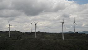 Real time of a wind turbine farm on top of a hill in Northeastern Portugal, renewable energy concept.  stock video