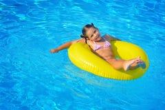 Real toddler girl relaxing at swimming pool Royalty Free Stock Image