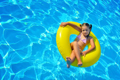 Real toddler girl relaxing at swimming pool Stock Images