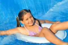 Real toddler girl relaxing at swimming pool Royalty Free Stock Photos