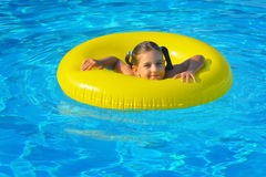 Real toddler girl relaxing at swimming pool Royalty Free Stock Images