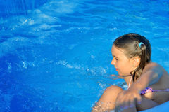 Real toddler girl relaxing at swimming pool Royalty Free Stock Photography