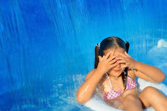 Real toddler girl relaxing at swimming pool Stock Photo