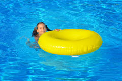 Real toddler girl relaxing at swimming pool Stock Image