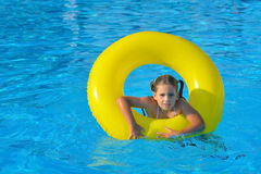Real toddler girl relaxing at swimming pool Stock Photography
