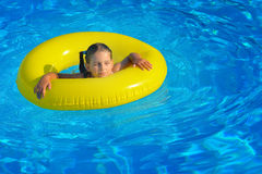 Real toddler girl relaxing at swimming pool Royalty Free Stock Photo