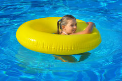 Real toddler girl at swimming pool Stock Images