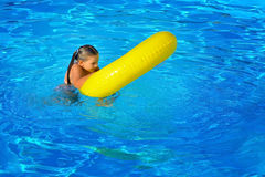 Real toddler girl at swimming pool Royalty Free Stock Photo