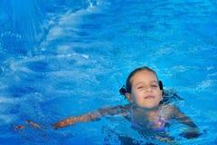 Real toddler girl at swimming pool Stock Photos