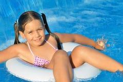 Real toddler girl at swimming pool Stock Image