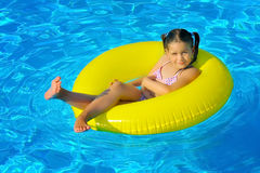 Real toddler girl at swimming pool Royalty Free Stock Photography