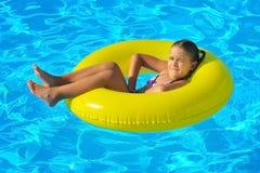 Real toddler girl at swimming pool Royalty Free Stock Photos