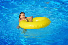 Real toddler girl at swimming pool Stock Photography