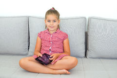 Real toddler girl working homework with tablet device Royalty Free Stock Image