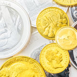 Real value in golden and silver coins. Silver koala, phillharmoniker and golden phillharmoniker, buffalo, kangaroo and franz joseph royalty free stock photography