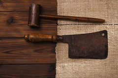 Real vintage wooden mallet and iron meat cleaver Royalty Free Stock Image