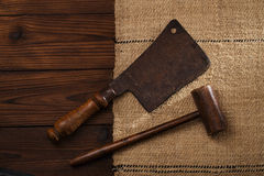 Real vintage wooden mallet and iron meat cleaver Stock Photos