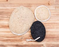 Real volcanic pumice stone and natural loofah sponge Stock Photography