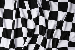 Real waving checkered flag. This is a real checkered flag of high quality - texture details in the material stock image