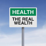 The Real Wealth. A conceptual sign on Health and Wellness Stock Photo