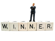 A real winner standing on the word. There are always winners and losers stock photography