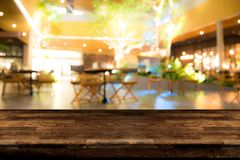 Real wood table with appetizer and light reflection on scene at royalty free stock photos