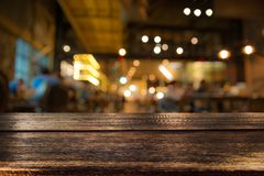 Real wood table with appetizer and light reflection on scene at stock photography