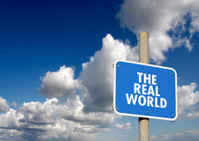 The real world signpost. With blue sky and clouds Stock Photos