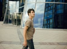 Real young man stand in front of modern business Royalty Free Stock Images