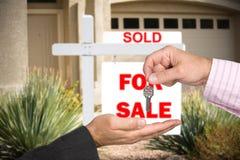 Realator handing over keys royalty free stock photos