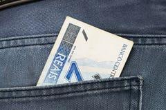 Reale brasiliano in tasca dei jeans Fotografia Stock