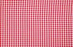 Reale weiße und rote Tischdecke Stockbild